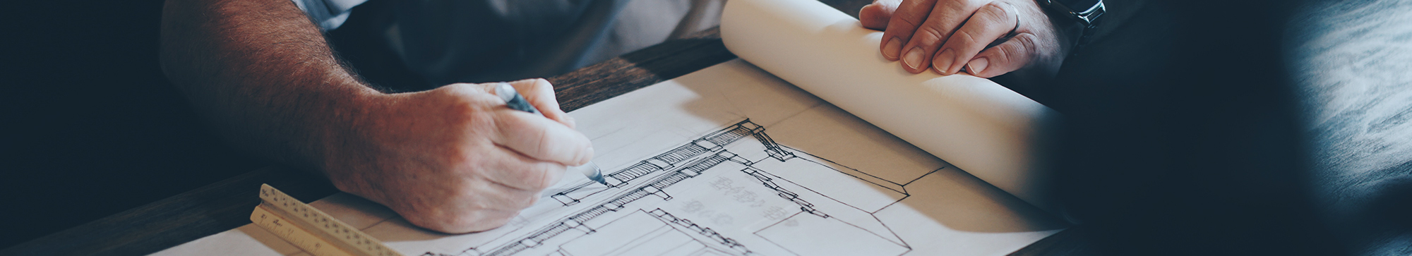Man working on blueprint